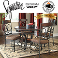 Scrolling Old World Design With Tempered Glass Insert On Table Top Highlight This 5PC Dinette Set