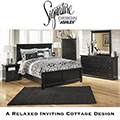 FREE Pair Of Lamps With This 8-Piece Bedroom Set Featuring Solid Black Finish With Pewter Accents