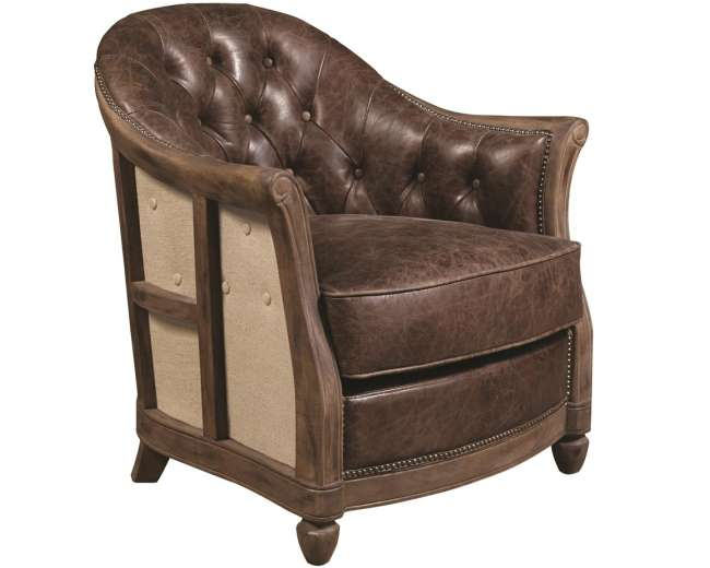 old world button tufted leather nail head trim define this classic