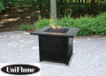 UniFlame Outdoor LP Gas Fireplace Featuring A Slate Tile Mantle & Hidden Control Panel W/Black Glass